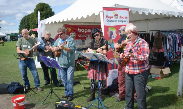 Ukelele players performing outside the Hope House stall at Shrewsbury Folk Festival 2014 - credit Mike Dean